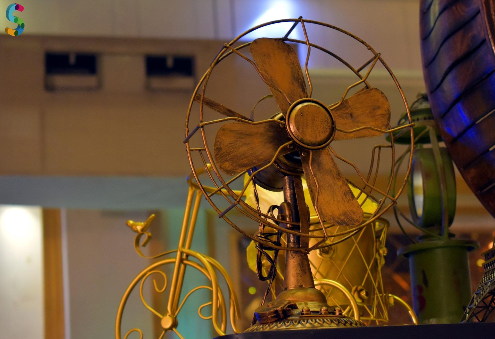 Ancien ventilateur en cuivre et laiton